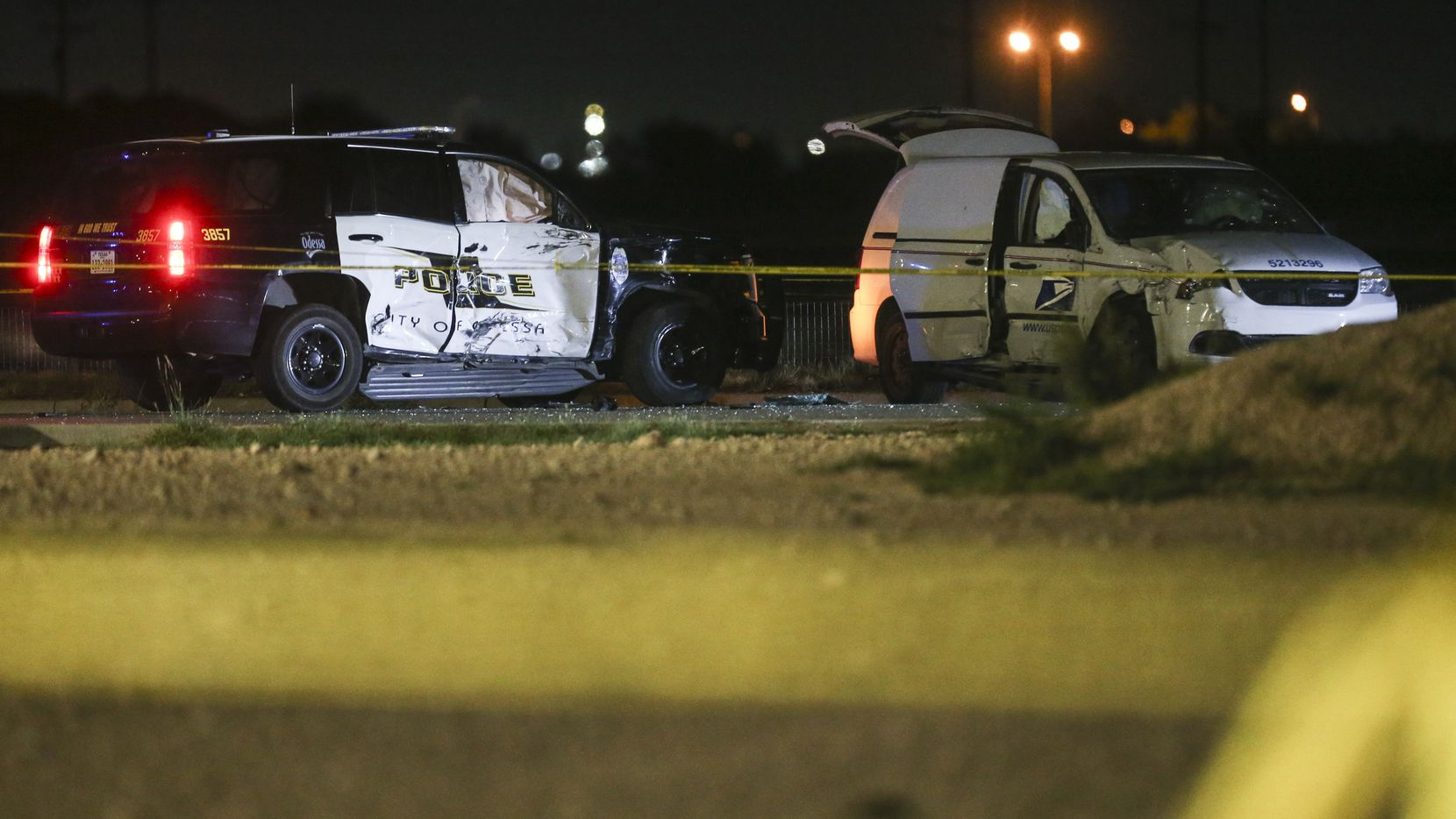 A crashed U.S. Postal Service vehicle and Odessa Police vehicle are seen Saturday, Aug. 31, 2019 at a Cinergy movie theatre in Odessa, Texas. At least five people died after more than 20 people were shot Saturday when a gunman hijacked a postal truck and began shooting randomly in the Odessa area of West Texas, authorities say.