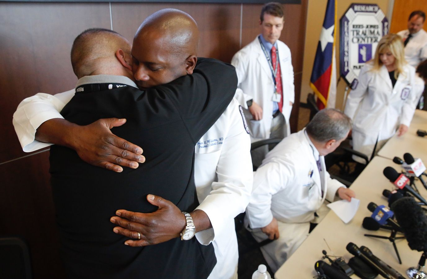 Dr. Alexander Eastman (left), medical director/chief of Rees-Jones Trauma Center, and Dr. Brian Williams, staff surgeon, Rees-Jones Trauma Center, embraced after speaking about the mass shooting of Dallas police officers at an emotional press conference at Parkland Hospital.