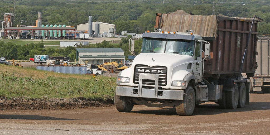 Trucks travel along the road at the McCommas Bluff Landfill at 5100 Youngblood Road in Dallas on Thursday, Aug. 16, 2018.