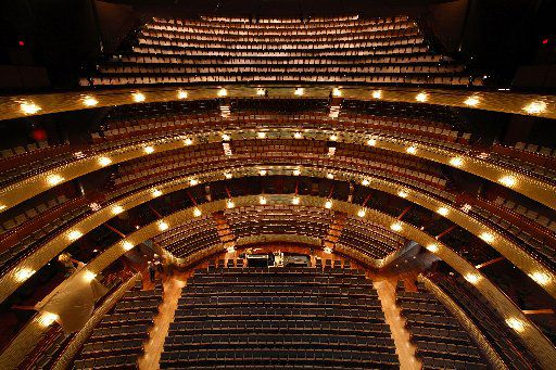 Befitting Margaret McDermott's exquisite artistic tastes, a ribbon of white gold leaf encircles four levels of seating at the Winspear Opera House's Margaret McDermott Performance Hall. (Tom Fox/The Dallas Morning News)