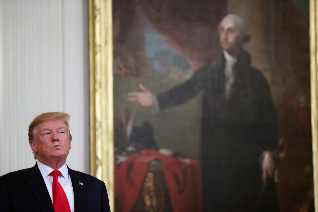 President Donald Trump stands near a portrait of George Washington at a Wounded Warrior Project Soldier Ride event in the East Room of the White House on April 18, 2019, in Washington. (AP Photo/Andrew Harnik)