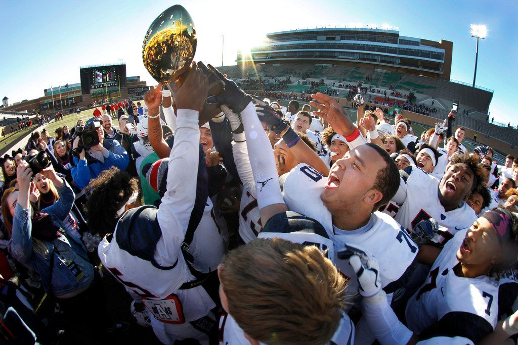 Euphoria filled the air as members of the Allen Eagles celebrate their 41-20 victory over Euless Trinity and are presented the 6A state quarterfinal trophy following the game which advances them in the playoffs. The  teams played their Class 6A Division l Region l final football game at The University of North Texas' Apogee Stadium on December 9, 2017. (Steve Hamm/Special Contributor)