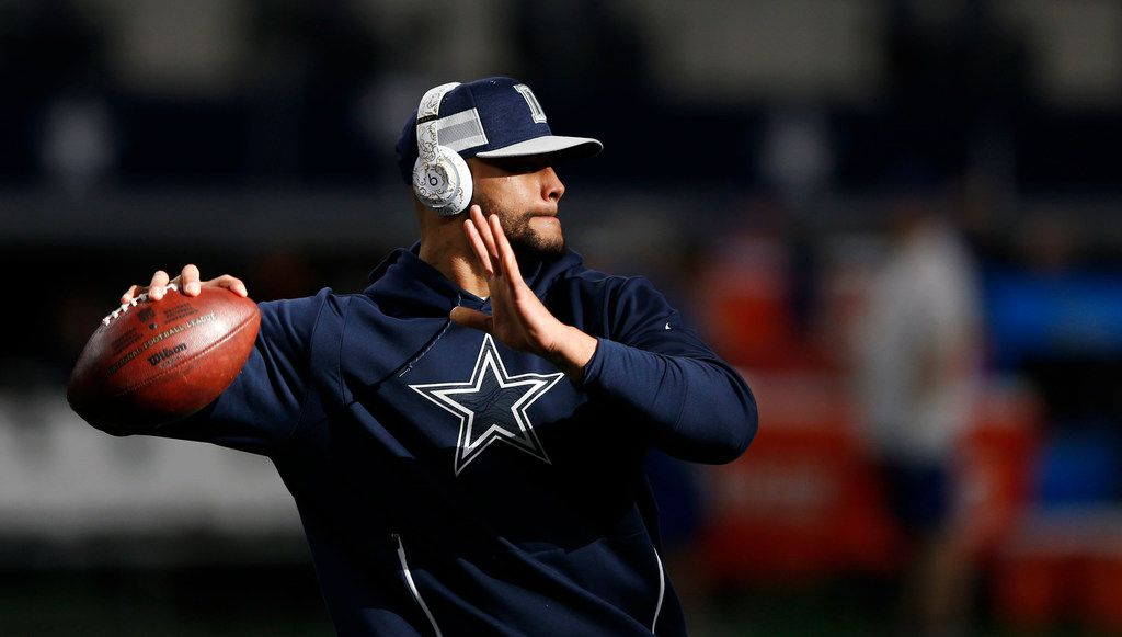Dallas Cowboys quarterback Dak Prescott (4) throws the football before a game against the Tampa Bay Buccaneers at AT&T Stadium in Arlington on Sunday, December 23, 2018. (Vernon Bryant/The Dallas Morning News)