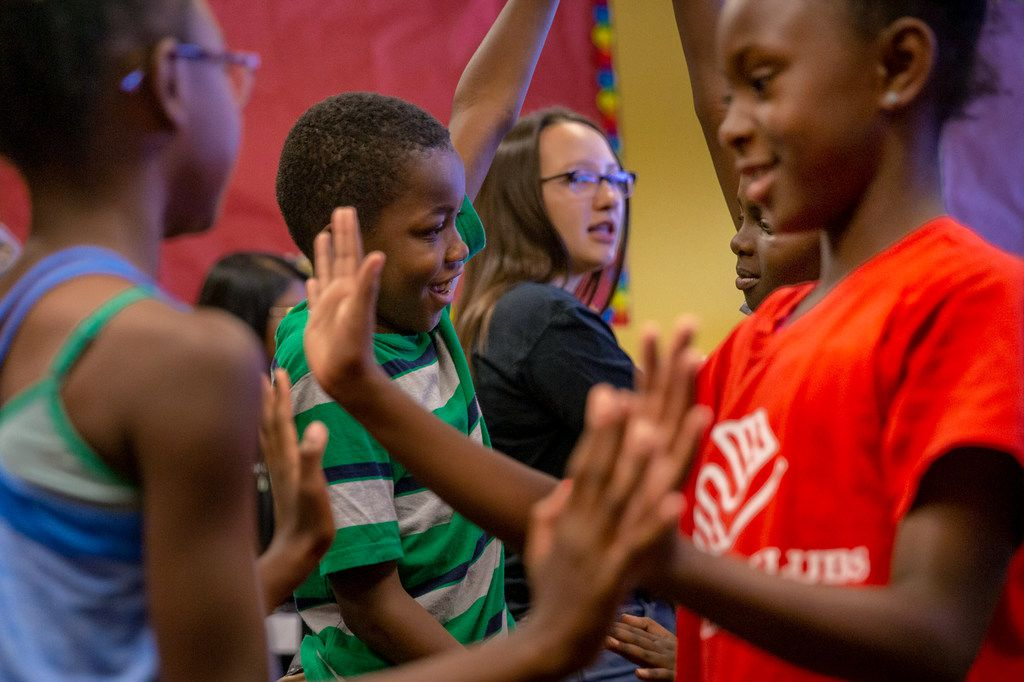 Theodore Penn, 10 (center) and Aaliyah Wills, 9 (right), participate in a pantomime exercise during a theatre class presented by Humanities of Tomorrow at the Boys and Girls Club in Frisco, Texas, on Wednesday, July 31, 2019. The Humanities of Tomorrow program was founded by high school students to offer an arts and humanities curriculum to children during one-week programs.