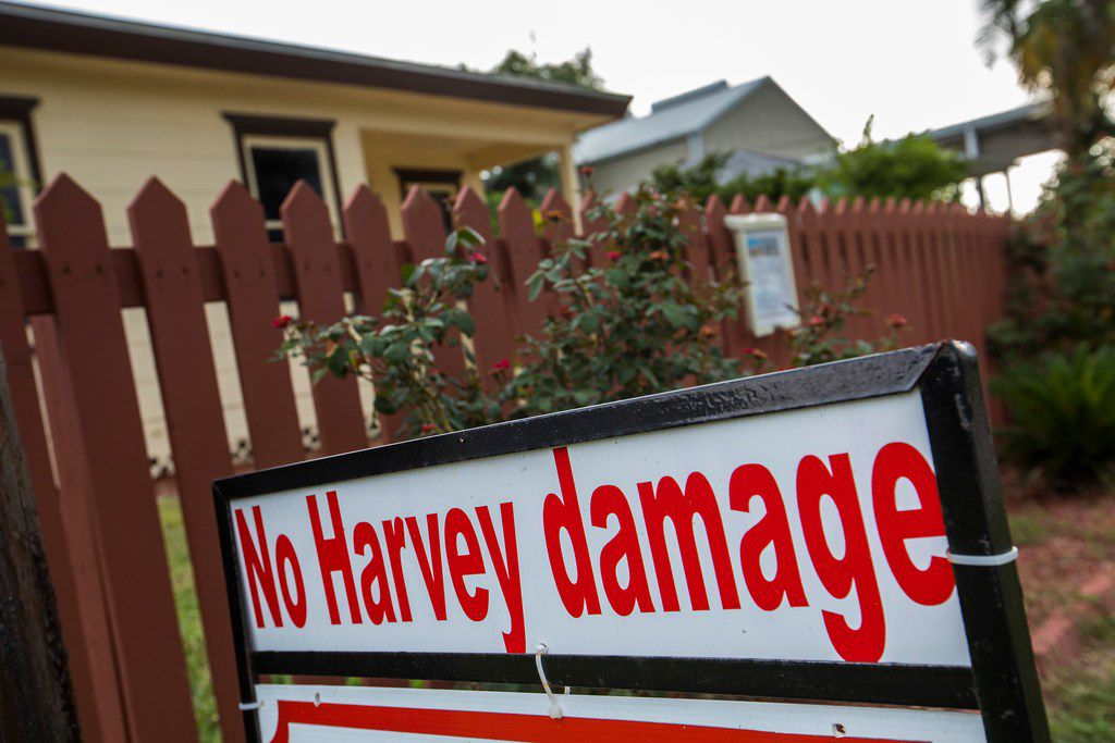 A for-sale sign on a property in Port Aransas advertises that it suffered no damage when Hurricane Harvey devastated the Texas Gulf Coast city in August 2017.