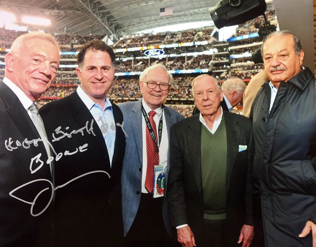 A handful of billionaire buddies lined up for a photo at the Super Bowl on Feb. 6, 2011, at Cowboys Stadium in Arlington. Left to right: Cowboys owner Jerry Jones, Dell founder Michael Dell, investor Warren Buffett, energy mogul T. Boone Pickens and Mexican magnate Carlos Slim. Slim was ranked as the world's richest man by Forbes at the time. Currently, Slim is No. 5, Buffett is No. 3, Dell is No. 25 and Jerry Jones is No. 224. Pickens made the list in 2013 before he started giving his money away. Jerry Jones gave this photo to T. Boone Pickens for his birthday.