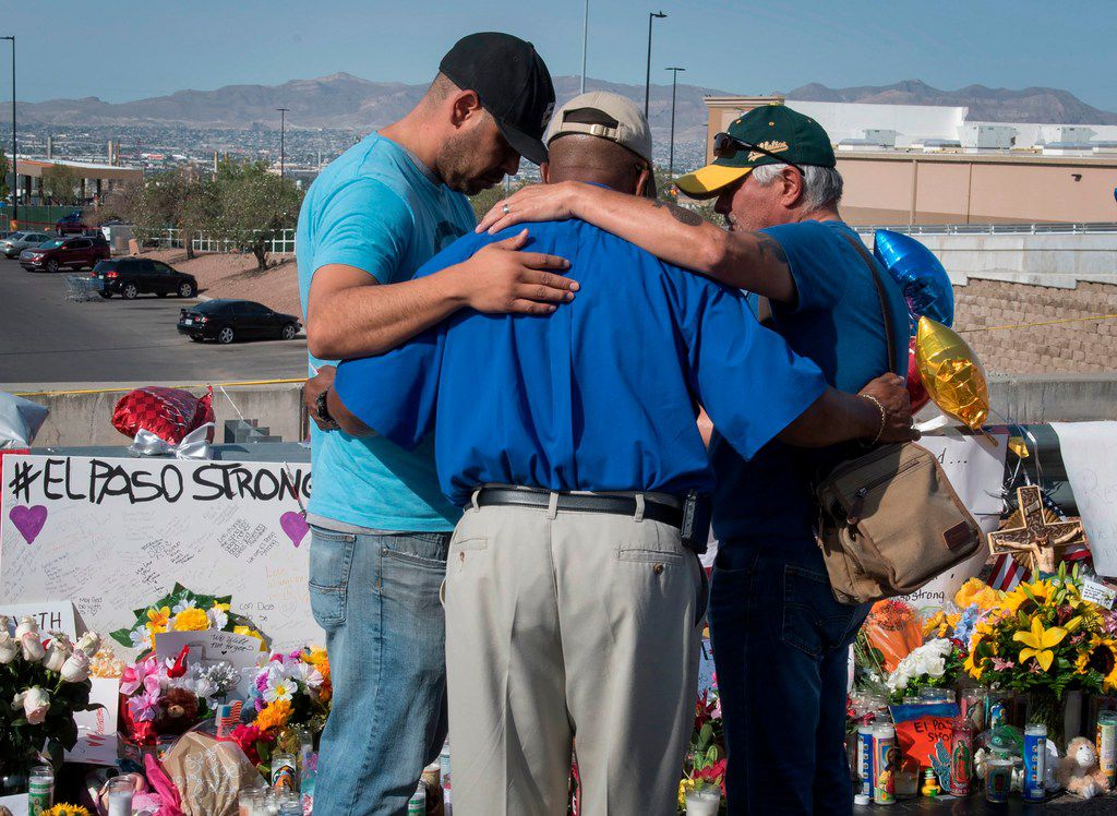 People prayed at the makeshift memorial for victims of the shooting that left a total of 22 people dead at the Cielo Vista Mall Walmart in El Paso on Aug. 7, 2019.