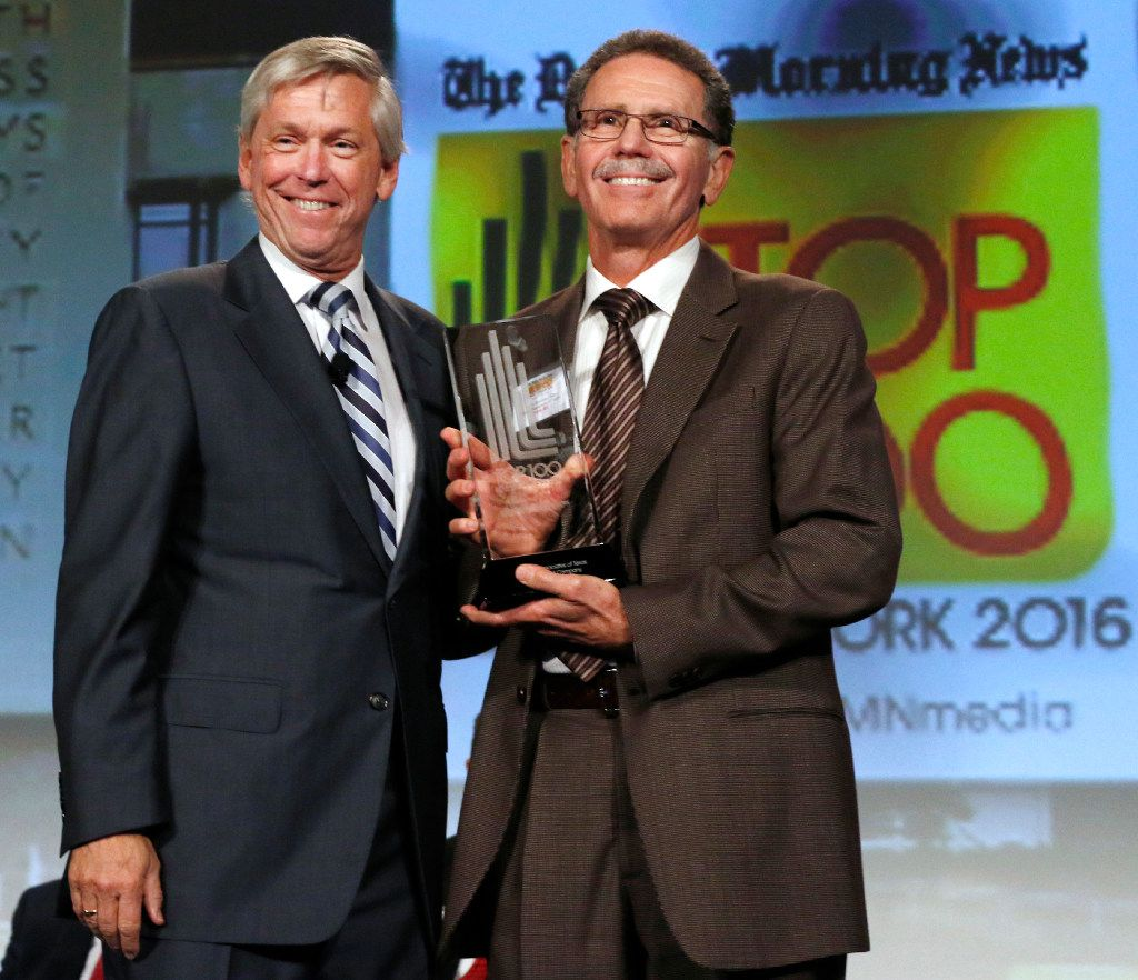 Jim Moroney, Publisher and CEO of the Dallas Morning News, left, poses with Dr. Henry Gelender of Cornea Associates of Texas after wining the award for best small company in the Top 100 Place to Work luncheon at the Dallas Omni Hotel on Friday, November 17, 2016 in Dallas, Texas. (David Woo/The Dallas Morning News)