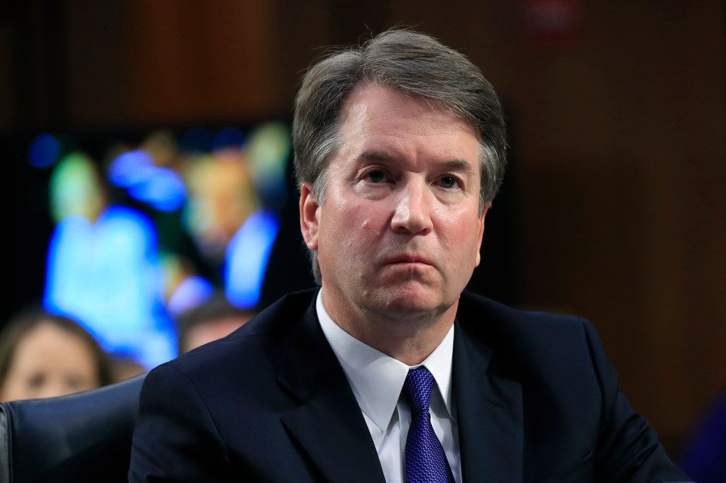 Supreme Court nominee Brett Kavanaugh listened to Sen. Cory Booker, D-N.J., during the Oct. 4 hearing of the Senate Judiciary Committee.