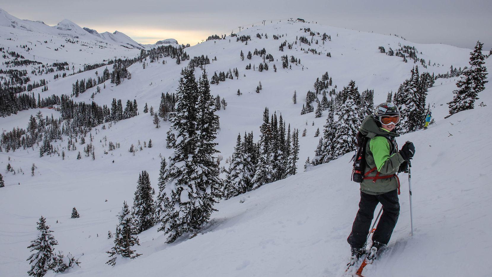 Reid Irwin, 11, enjoys the powder and the scenery in Banff National Park. The region's ski season runs through late April.