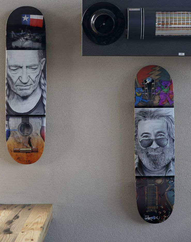 Pictures of music artists painted on skateboards hang on the wall at Rock & Brews in The Colony, Texas, Tuesday, March 8, 2016. (Jae S. Lee/The Dallas Morning News)