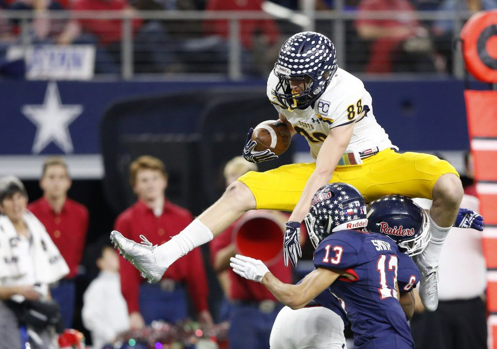 Highland Park's Cade Saustad (88) attempts to leap over Denton Ryan's Tamar Butts (6) as teammate Tra Smith (13) closes in on the play to help during the first half of play in a Class 5A Division I state semifinal at AT&T Stadium in Arlington, on Friday, December 15, 2017. (Vernon Bryant/The Dallas Morning News)