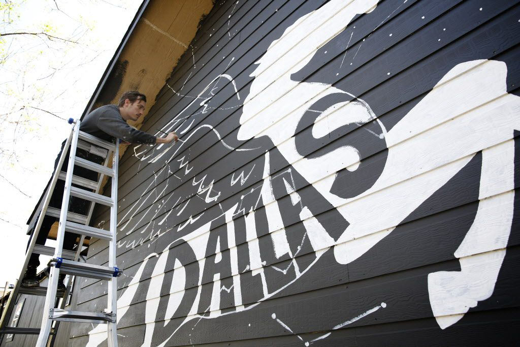 "Will Heron, also known as Wheron, works on his mural ""Dallaxy"" at The Platform, his gallery space in West Dallas on March 19, 2016. Wheron's new space will provide a place for a small, but budding art community to converge for gallery shows and collaborations. (Rose Baca/The Dallas Morning News)"