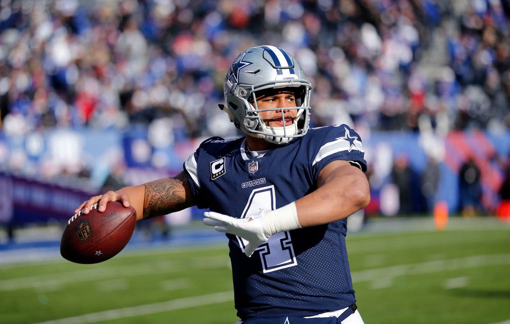 FILE - Cowboys quarterback Dak Prescott (4) warms up before a game against the New York Giants at MetLife Stadium in East Rutherford, N.J., on Sunday, Dec. 10, 2017. (Tom Fox/The Dallas Morning News)