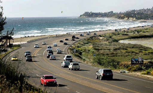 Motorists drive along California's Historic Highway 101 as it passes through Cardiff-by-the-Sea, about six hours south of San Luis Obispo.