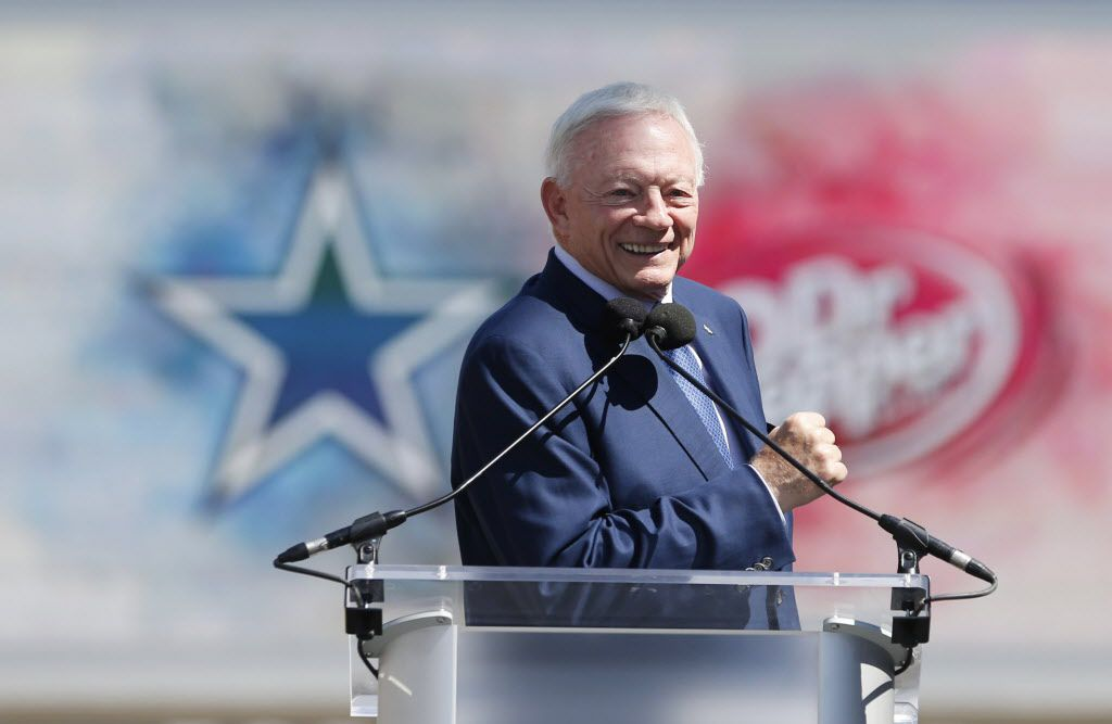 In front of the iconic brand logos of the Dallas Cowboys and DrPepper, Cowboys owner and general manager Jerry Jones speaks to the crowd during the Ring of Honor Walk unveiling ceremony at The Star in Frisco, Texas on Monday, August 21, 2017. (Vernon Bryant/The Dallas Morning News)