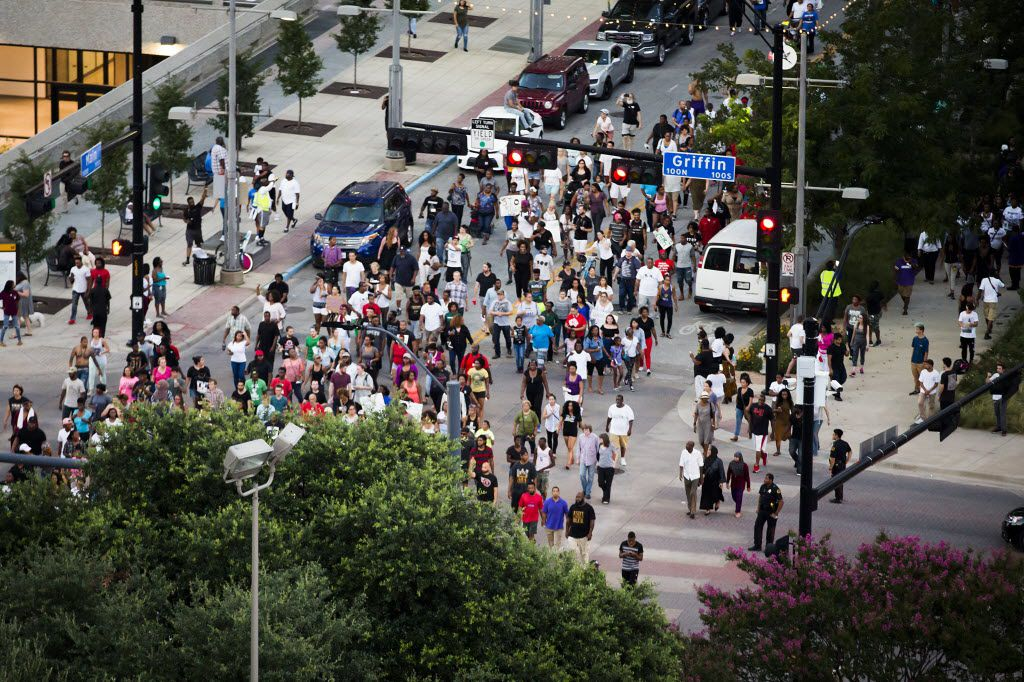 Demonstrators in Black Lives Matter march pass through the intersection of Main and Griffin as seen from a parking garage in downtown Dallas on Thursday, July 7, 2016. As the rally and march were winding down, Micah Xavier Johnson, 25, opened fire in an attack that killed five police officers and wounded seven other officers and two civilians.
