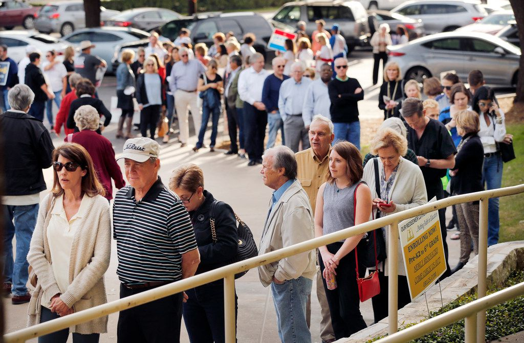 A long line of voters wait to early vote at Our Redeemer Lutheran Church and School on Park Lane in Dallas, Tuesday, October 23, 2018., the second day of early voting.