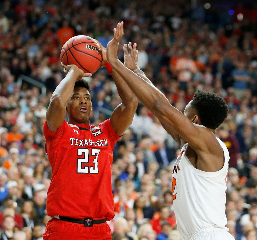 Texas Tech's Jarrett Culver (23) shoots over Virginia's De'Andre Hunter (12) during the first half of the NCAA championship game. Each were NBA lottery picks on Thursday. (Vernon Bryant/The Dallas Morning News)