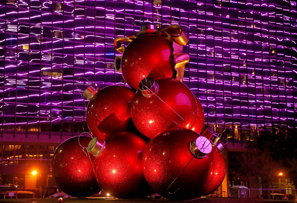 The Omni's big, red ornaments weigh 1,200 apiece. They're set into place with a crane.