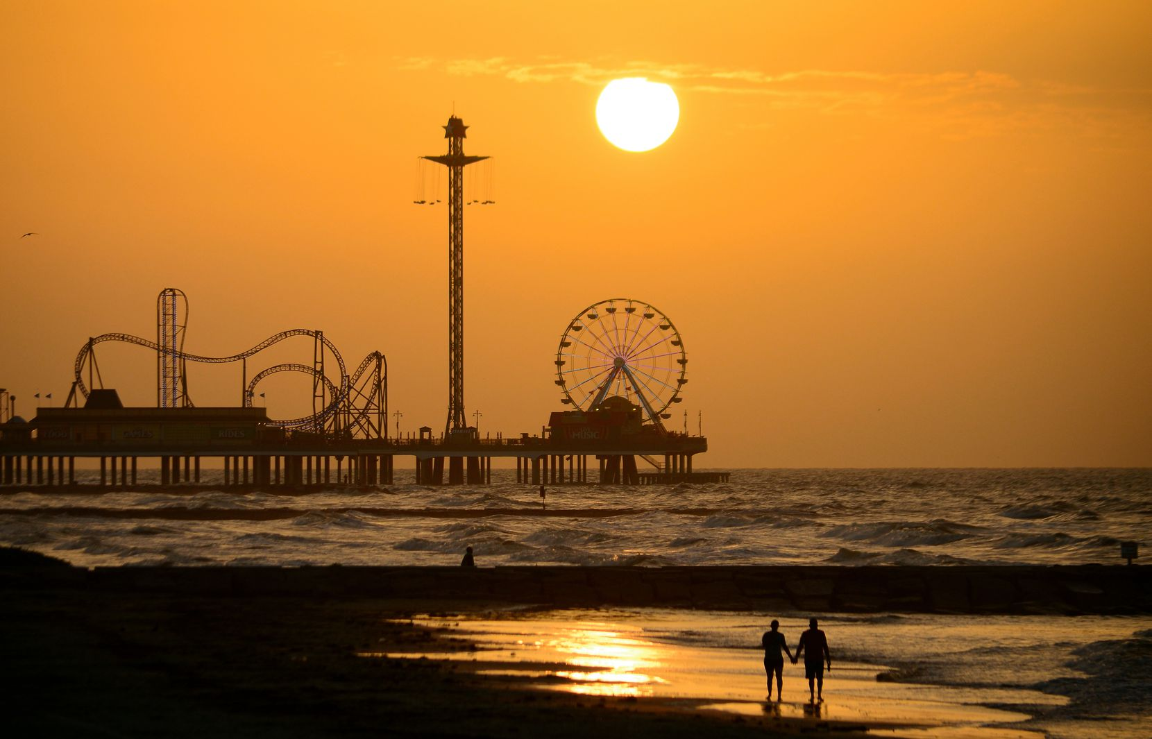 The historic Pleasure Pier is one of Galveston's iconic beach attractions.