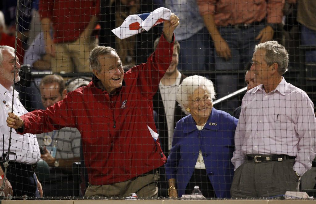 """Former President George H.W. Bush waves a towel as wife Barbara and son George W. Bush look on during the game between the Texas Rangers and San Francisco Giants during World Series game four at Rangers Ballpark in Arlington in 2010. The elder President Bush, who died Friday night, was hailed for his authenticity, disarming wit and for being a """"really nice person to be around."""""""