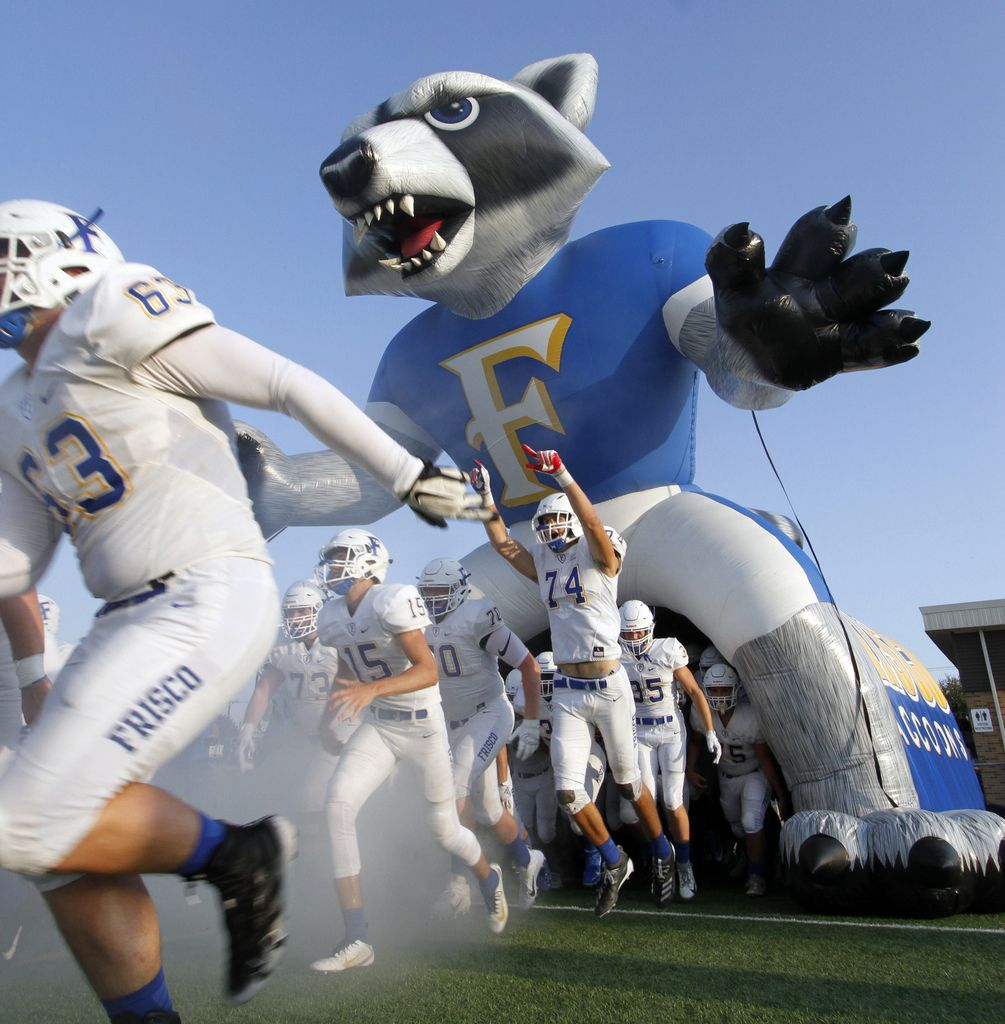 Frisco offensive lineman John Lilly (74) leaps with excitement as he and Raccoon teammates run through the team inflatable mascot to start their 2019 season against Dallas Woodrow Wilson. The two teams competed in their season-opening non-district football game at Franklin Stadium in Dallas on August 29, 2019. (Steve Hamm/ Special Contributor)