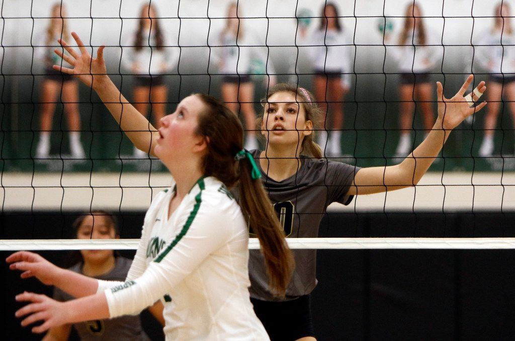 Mansfield outside hitter Molly Phillips (20) is a towering defensive presence as Waxahachie junior Ragan Ward (2) lines up to set up a shot during the first match. Waxahachie defeated Mansfield, 25-14, 25-19, 25-19. The two teams played their district  District 7-6A match  at Waxahachie High School on September 25, 2018.  (Steve Hamm/ Special Contributor)