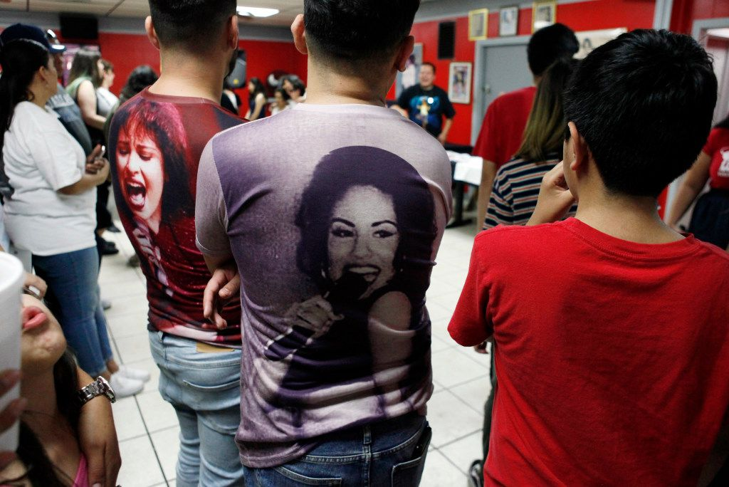 Jeremy Vazquez, 23, left, and Eric Calderon, 26, sport Selena shirts as they watch people dance to Selena songs during #214Selena: A Tribute to Selena at Country Burger restaurant in Dallas, Saturday, March 25, 2017.