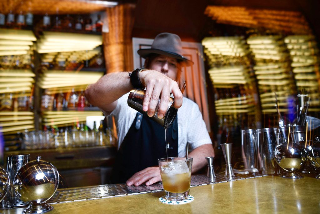 Co-creator Chad Solomon, of the Midnight Rambler bar, mixes a Cuffs and Buttons cocktail inside the bar at the Joule Hotel in downtown Dallas, Monday Aug. 20, 2019. Ben Torres/Special Contributor