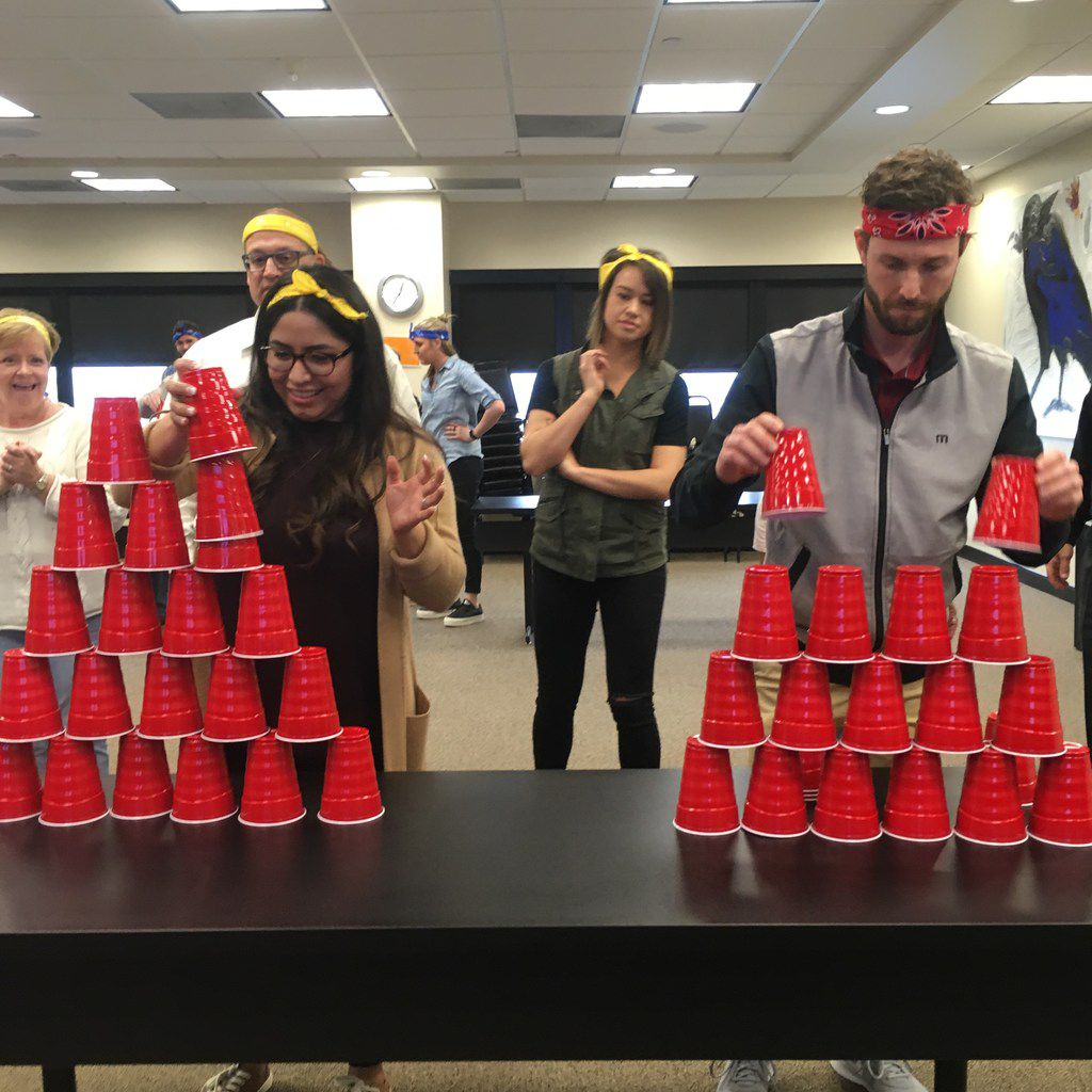 In celebration of the 2018 Winter Olympics, Republic Title of Texas held an extremely competitive) Office Olympics at its Corporate and Commercial headquarters Teams of five competed in games like cup-stacking.
