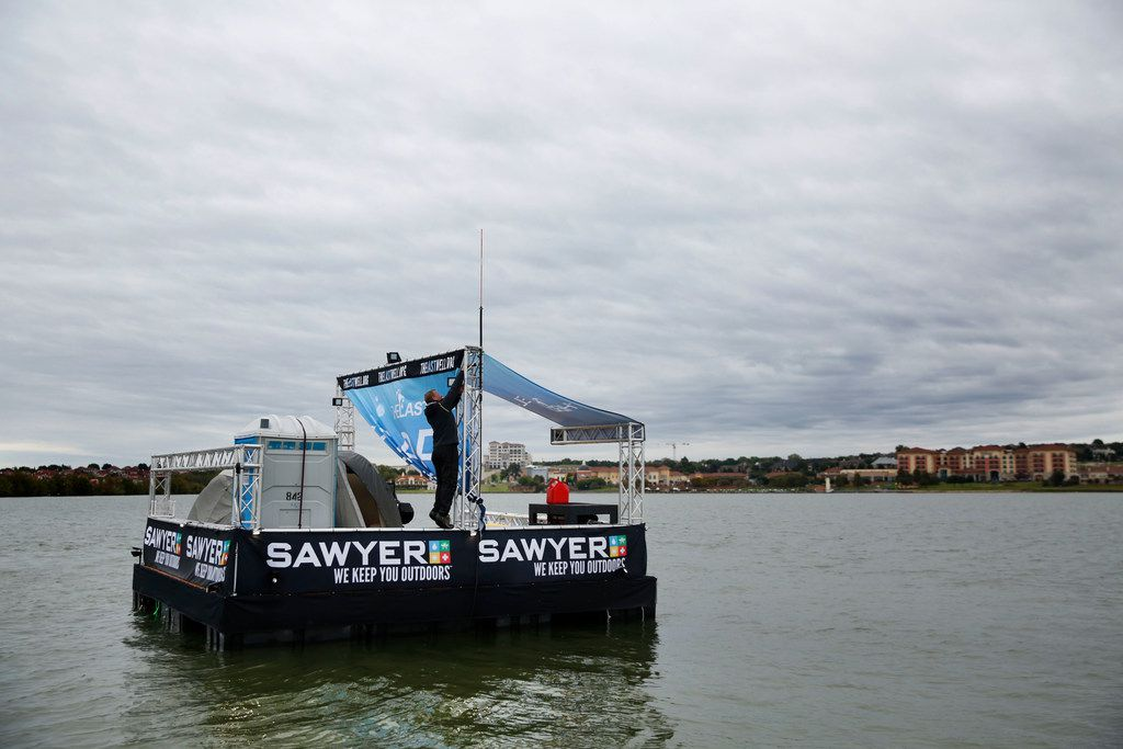 Todd Phillips, founder and director of the Last Well, makes repairs on Oct. 17, Day Eight on his wooden barge on Lake Ray Hubbard in Rockwall. Phillips is planning to stay on the barge until he raises $2 million to provide clean water to Liberians.