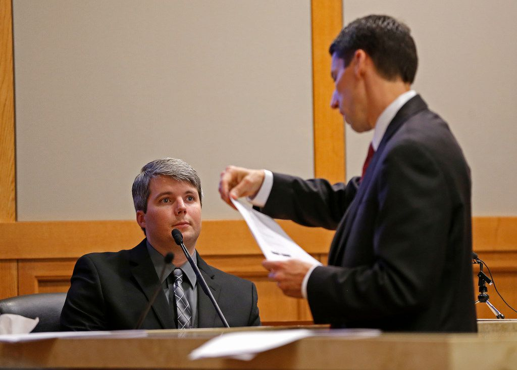 Prosecutor Wes Wynne (right) shows an document to defendant Jason Lowe during his murder trial  at the Collin County Courthouse in McKinney, Texas, Tuesday, Sept. 19, 2017.