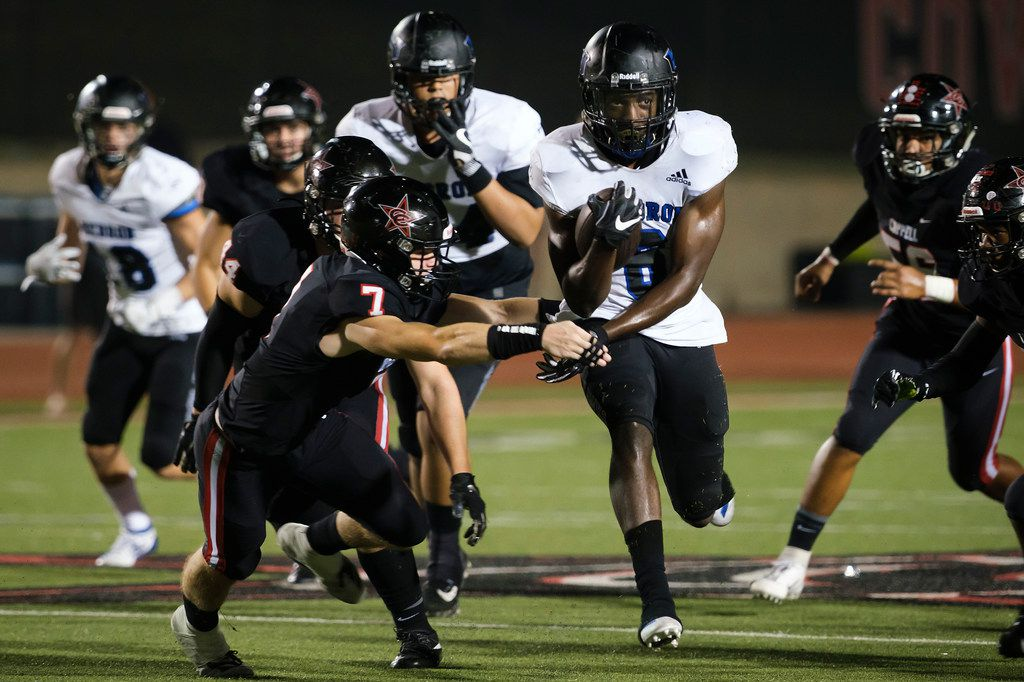 Hebron running back Jaylon Lott (6) breaks through the Coppell defense during the second half of a high school football game on Friday, Oct. 4, 2019, in Coppell, Texas. (Smiley N. Pool/The Dallas Morning News)