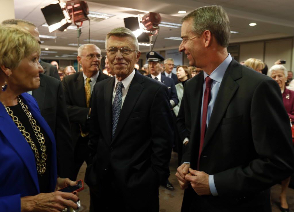 Fort Worth Mayor Betsy Price talked to former American Airlines CEOs Robert Crandall and Tom Horton as current CEO Doug Parker prepared to ring the opening bell for NASDAQ, celebrating the merger of American Airlines and US Airways, on Dec. 9. 2013.