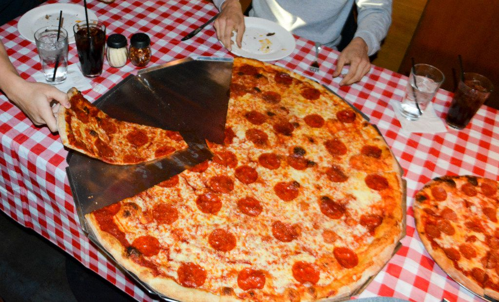 The bada Bing Challenge at Kenny's East Coast Pizza in Plano challenges people to eat a 32-inch, 10,000-calorie pizza.
