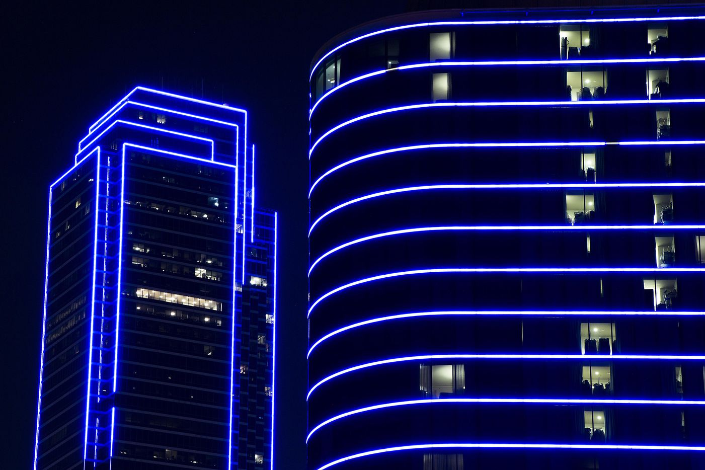 Bank of America and the Omni Dallas Hotel glow blue as the downtown Dallas skyline lights up in blue in recognition of National Police Week on Monday, May 15, 2017. (Smiley N. Pool/The Dallas Morning News)
