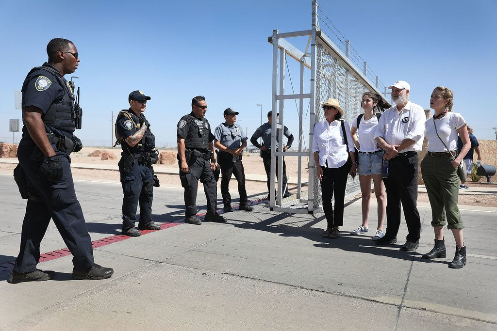 TORNILLO, TX - JUNE 24: Filmmaker Rob Reiner (2nd R) his wife Michele Reiner (L) and their daughter Romy Reiner (2nd L) speak with Department of Homeland Security police officers near the tent encampment recently built at the Tornillo-Guadalupe Port of Entry on June 24, 2018 in Tornillo, Texas. The Reiner family joined others to protest the separation of children from their parents after they were caught entering the U.S. under the administration's zero tolerance policy.  (Photo by Joe Raedle/Getty Images)