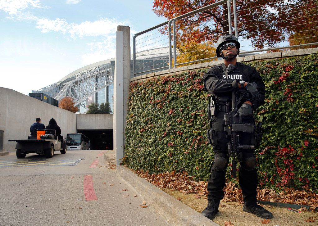 An armed Arlington SWAT officer stands guard at the AT&T Stadium tunnel entrance before the Big 12 Championship between the Oklahoma Sooners and TCU Horned Frogs at AT&T Stadium in Arlington on Dec. 2, 2017.