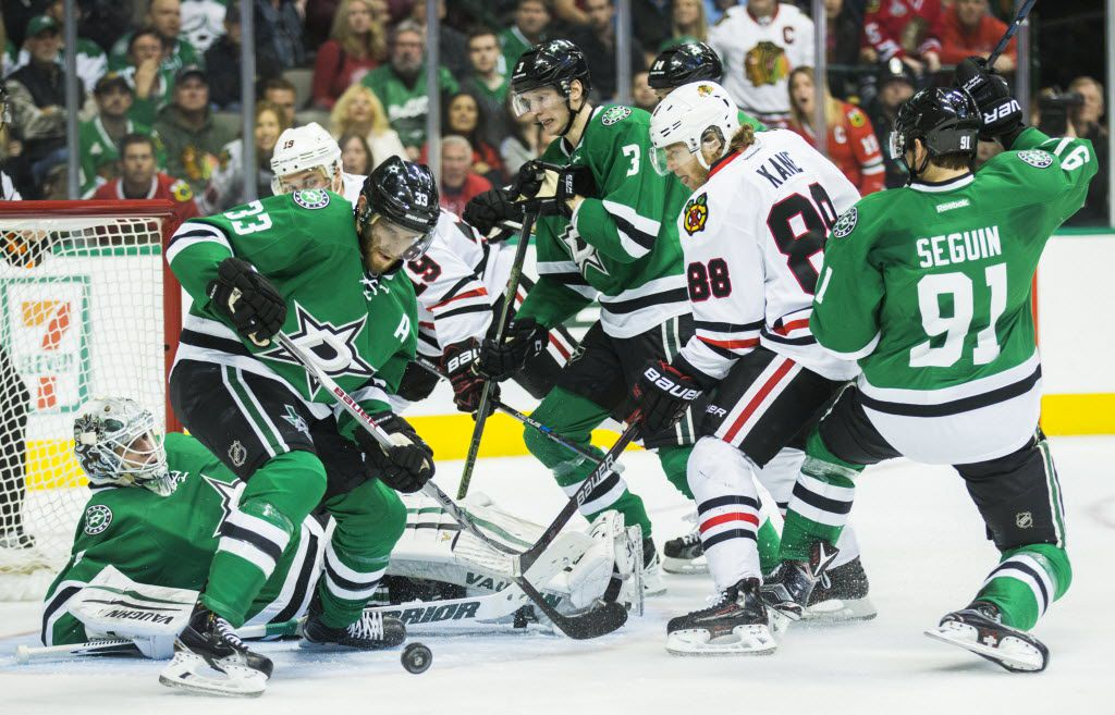 Dallas Stars defenseman Alex Goligoski (33) gets away from the goal with the puck after a scoring attempt by the Chicago Blackhawks during the second period of their game on Tuesday, December 22, 2015 at the American Airlines Center in Dallas. (Ashley Landis/The Dallas Morning News)