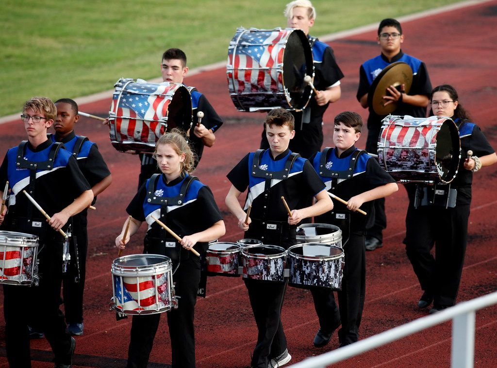 Members of the Trinity Christian Cedar Hill drum corps march along the track prior to the start of their game against Melissa. The two teams played their non-district football game at Charles Baldwin Stadium on the campus of Trinity Christian School in Cedar Hill on September 20, 2019. (Steve Hamm/ Special Contributor)