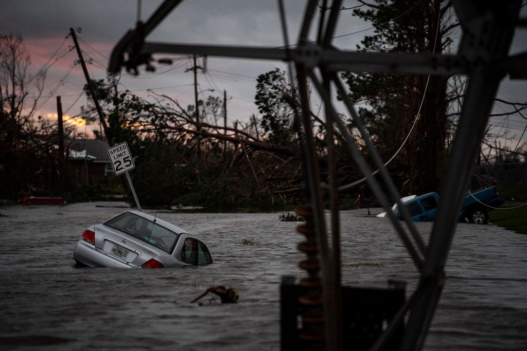 A car is caught in flood water in Panama City, Fla., after Hurricane Michael made landfall along the Florida panhandle on Oct. 10, 2018.