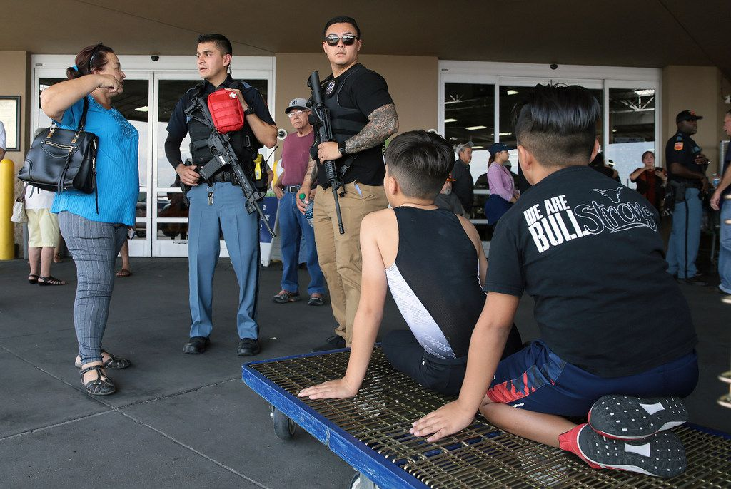 Police interview witnesses at Sam's Club where Walmart shoppers were evacuated near the scene of a shooting at a shopping mall in El Paso, Texas, on Saturday, Aug. 3, 2019.   Multiple people were killed and one person was in custody after a shooter went on a rampage at a shopping mall, police in the Texas border town of El Paso said.