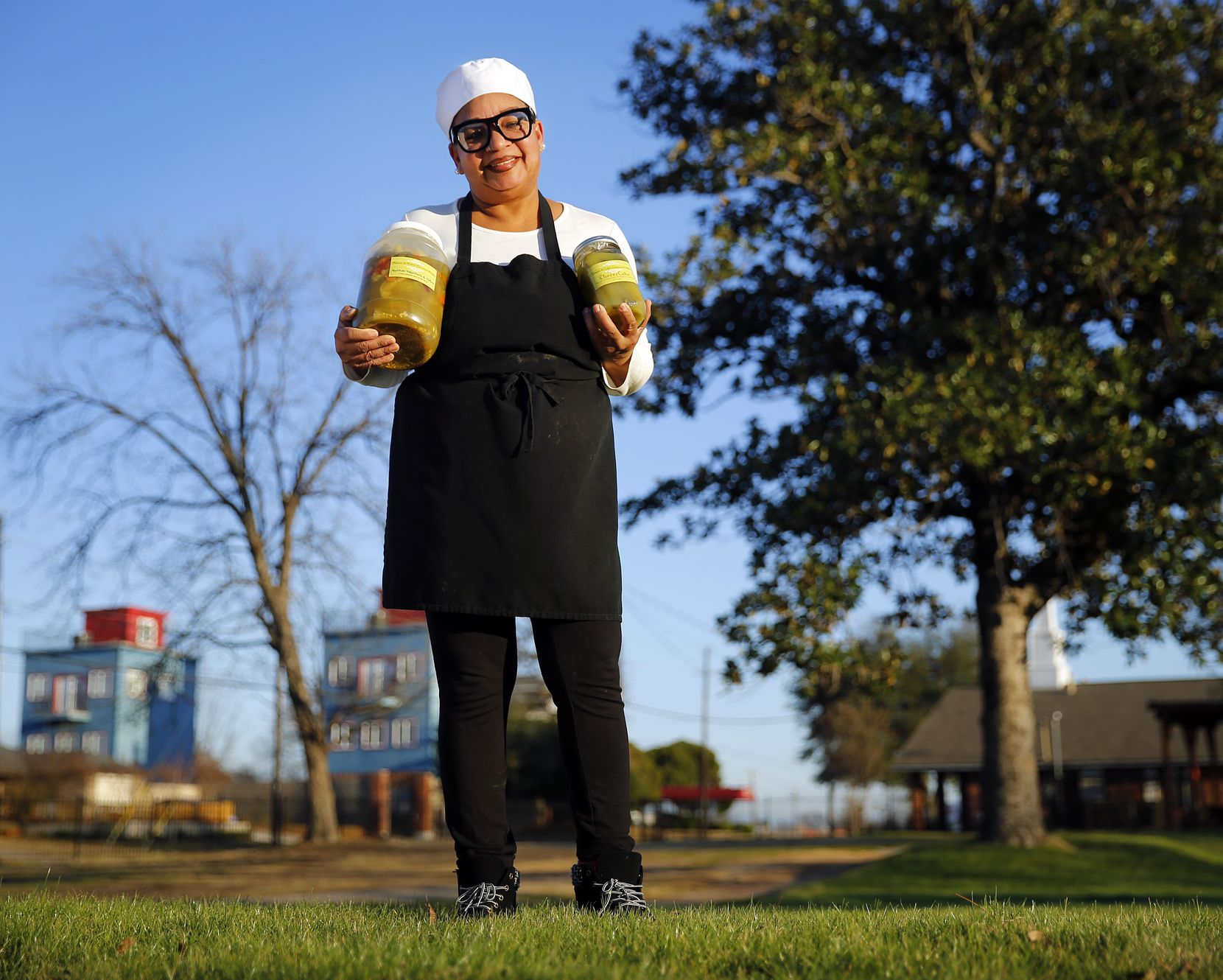 Pinson & Cole's Gourmet Pickles owner Stephanie Pinson-Cole poses with some of her most popular pickles at the Cornerstone Church Cafeteria. Since 2011, she has been making and perfecting 18 varieties of canned pickles, including Feisty, Sour Apples and Cheesecake.
