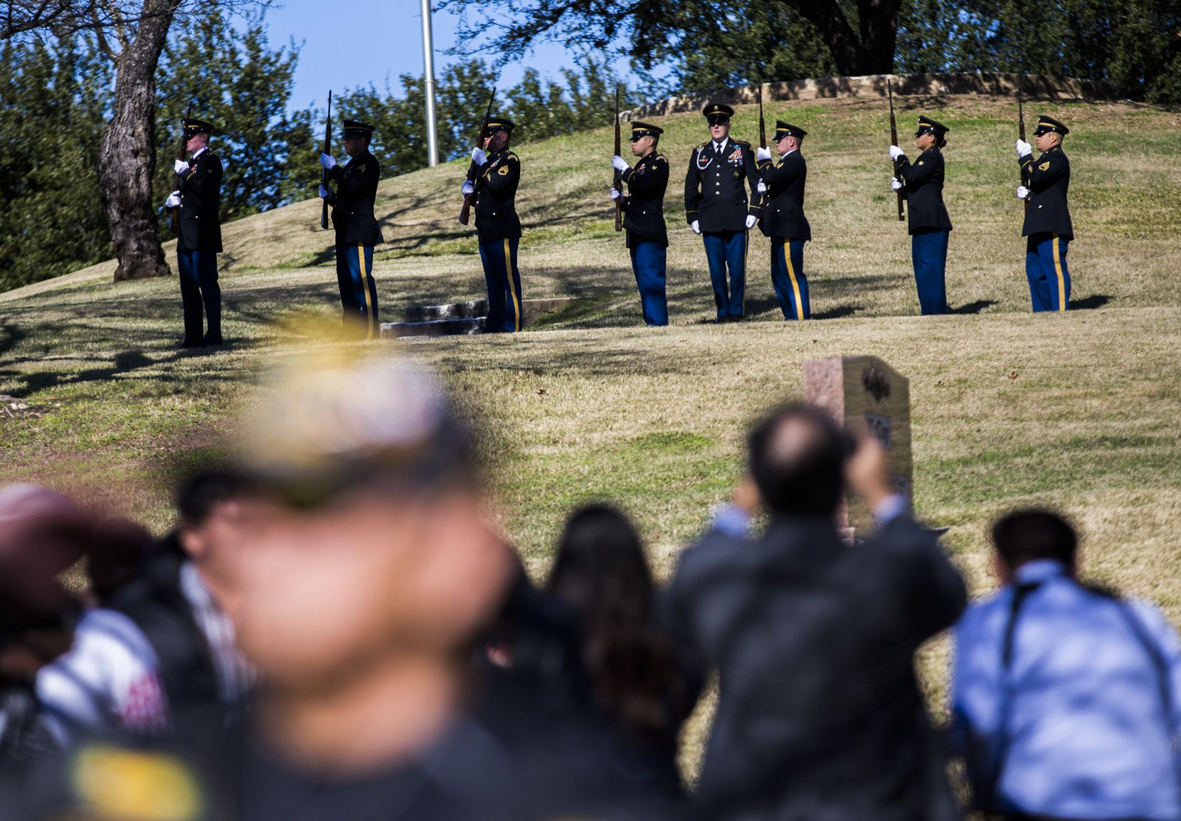 A 21-gun salute pays tribute to Richard Overton during a graveside service the Texas State Cemetery.