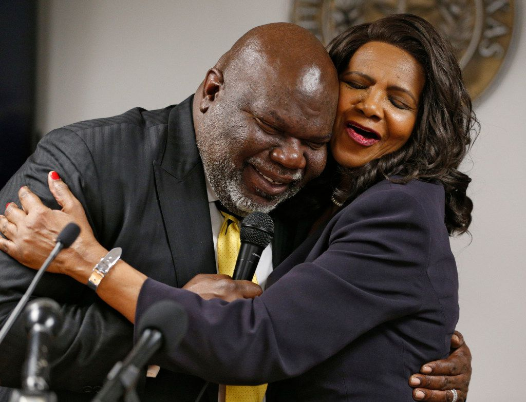 Bishop T.D. Jakes hugged Dallas County District Attorney Faith Johnson after she was sworn in Monday at the Frank Crowley Courts Building in Dallas.  (Nathan Hunsinger/Staff Photographer)
