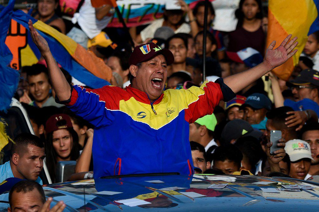 Venezuelan opposition presidential candidate Henri Falcon gestures during the closing rally of his campaign ahead of the weekend's presidential election, in Barquisimeto, Lara state, Venezuela on May 17, 2018.