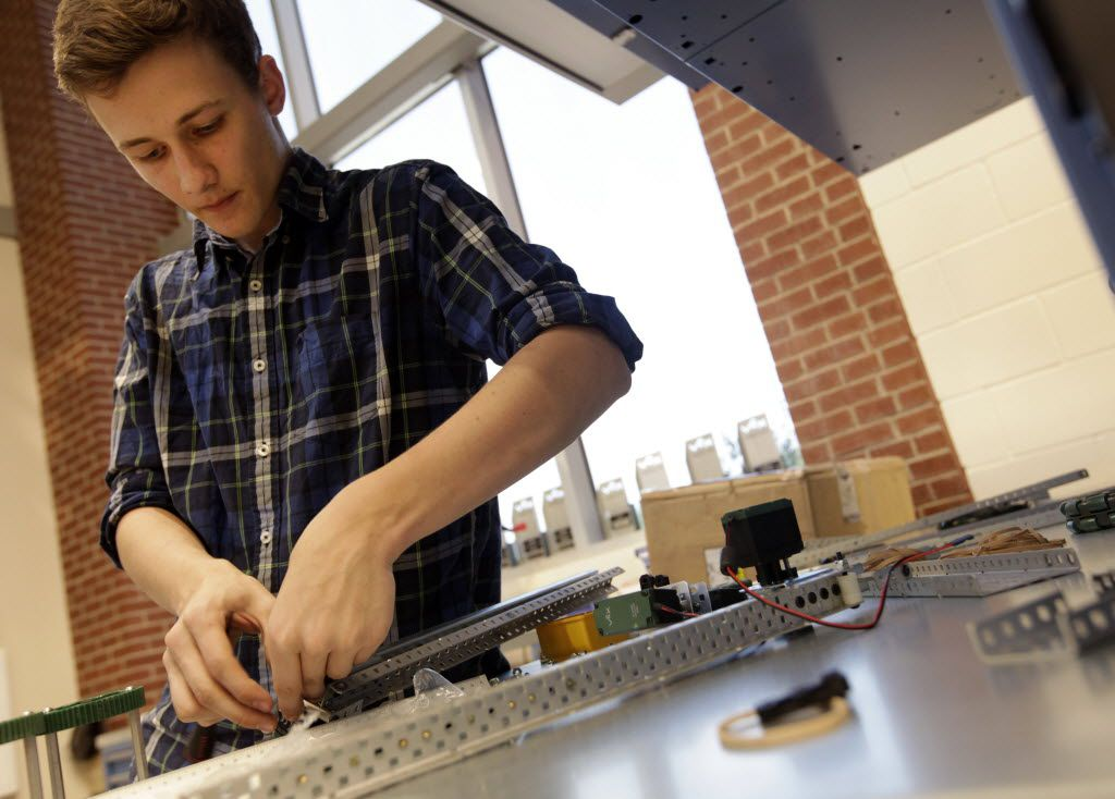 Connor Redding, 17, works on a project in a robotics class at Lovejoy High School in Lucas. (Jason Janik/Special Contributor)
