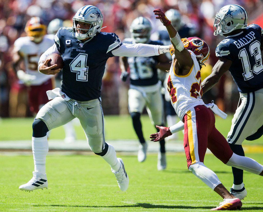 Dallas Cowboys quarterback Dak Prescott (4) stiff arms Washington Redskins cornerback Josh Norman (24) during the second quarter of an NFL game between the Dallas Cowboys and the Washington Redskins on Sunday, September 15, 2019 at FedExField in Landover, Maryland.
