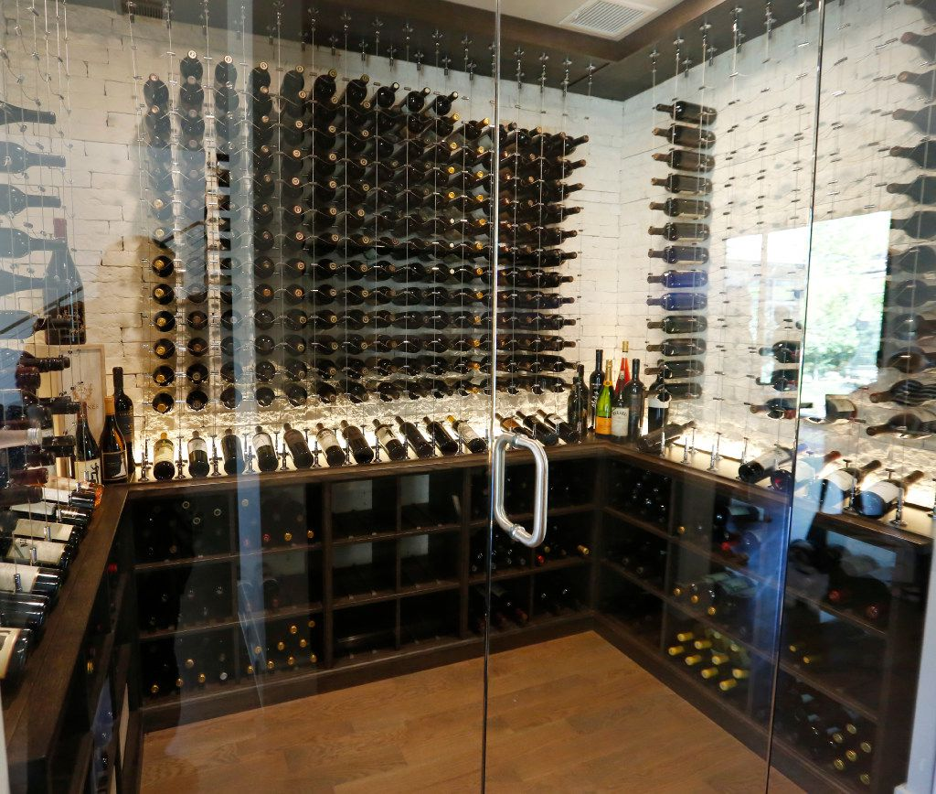 The glass-encased wine cellar at Scott and Erin Calaway's home.(Ron Baselice/The Dallas Morning News)